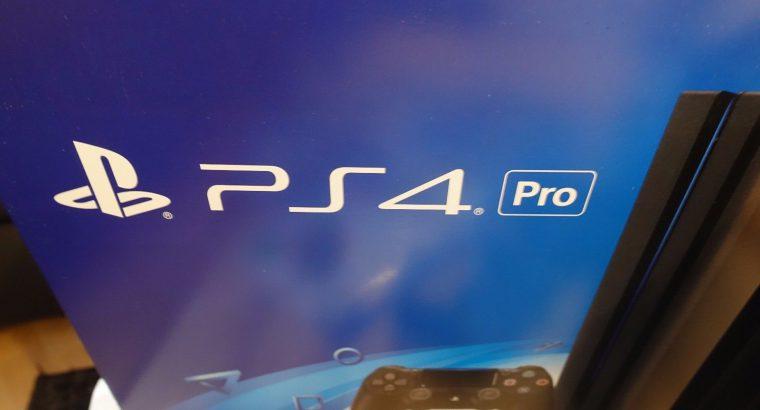 Sony PlayStation 4 Pro + 1TB + 2 controls + 5 games + PS Camera